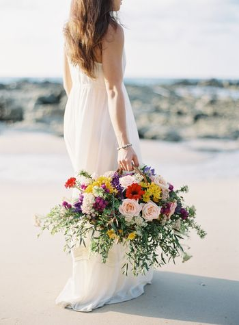 a-beachside-engagement-shoot-with-bright-flowers-in-phuket-1